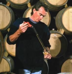 Red wine maturing in oak barrels