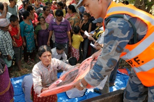 A-distribution-of-tents-and-tarpaulins-funded-by-Caritas-to-the-victims-of-the-earthquake-in-Kavrepalanchowk-district-03