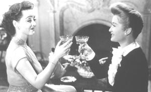 Bette Davis & Ann Baxter show the wrongs and rights of coupe champagne glass holding in 'All About Eve' 1950